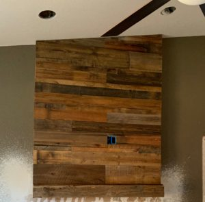 reclaimed wood mantel and impact wall